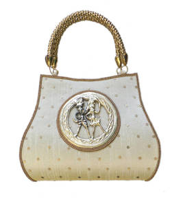 Raw silk handbag with round tribal brooch (light gold)