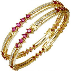 Precious 18k gold bangle with gemstones diamond and ruby